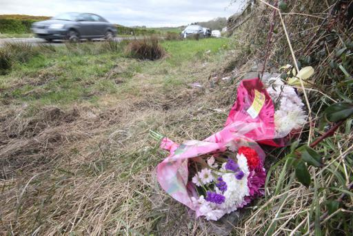 Flowers at the scene where a 56-year-old Ballymoney man was killed when his car collided with a lorry