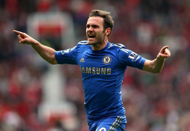 MANCHESTER, ENGLAND - MAY 05: Juan Mata of Chelsea celebrates after scoring the winning goal during the Barclays Premier League match between Manchester United and Chelsea at Old Trafford on May 5, 2013 in Manchester, England. (Photo by Alex Livesey/Getty Images)