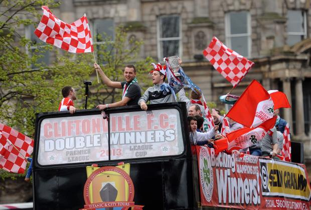 Ciaran Caldwell and Jamie McGovern as Premier League and League Cup double winners Cliftonville get an open top bus tour across Belfast to celebrate with their fans on Sunday