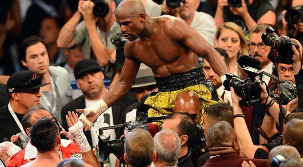 LAS VEGAS, NV - MAY 04: Floyd Mayweather Jr. celebrates his unanimous decision victory against Robert Guerrero in their WBC welterweight title bout at the MGM Grand Garden Arena on May 4, 2013 in Las Vegas, Nevada. (Photo by Ethan Miller/Getty Images)