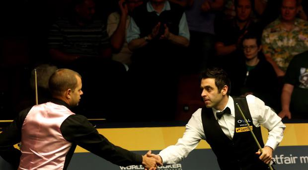 SHEFFIELD, ENGLAND - MAY 05: Ronnie O'Sullivan of England shakes hands with opponent Barry Hawkins of England during the final of the Betfair World Snooker Championship at the Crucible Theatre on May 5, 2013 in Sheffield, England. (Photo by Warren Little/Getty Images)