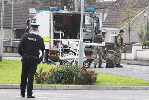 Army experts at the scene on the Garryduff Road in Ballymoney where two viable pipe bombs were discovered at a house Pic: Mark Jamieson