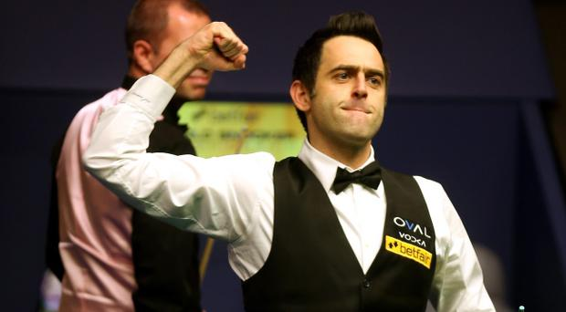 Ronnie O'Sullivan celebrates beating Barry Hawkins of England to win the Betfair World Snooker Championship at the Crucible Theatre on May 6, 2013 in Sheffield, England