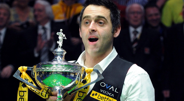 Ronnie O'Sullivan celebrates with the trophy after winning the final match during the Betfair World Championships at the Crucible, Sheffield. PRESS ASSOCIATION Photo. Picture date: Monday May 6, 2013. See PA story SNOOKER World. Photo credit should read: Anna Gowthorpe/PA Wire
