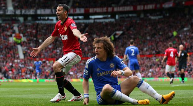 MANCHESTER, ENGLAND - MAY 05: Ryan Giggs of Manchester United appeals to the linesman after David Luiz of Chelsea goes to ground during the Barclays Premier League match between Manchester United and Chelsea at Old Trafford on May 5, 2013 in Manchester, England. (Photo by Alex Livesey/Getty Images)