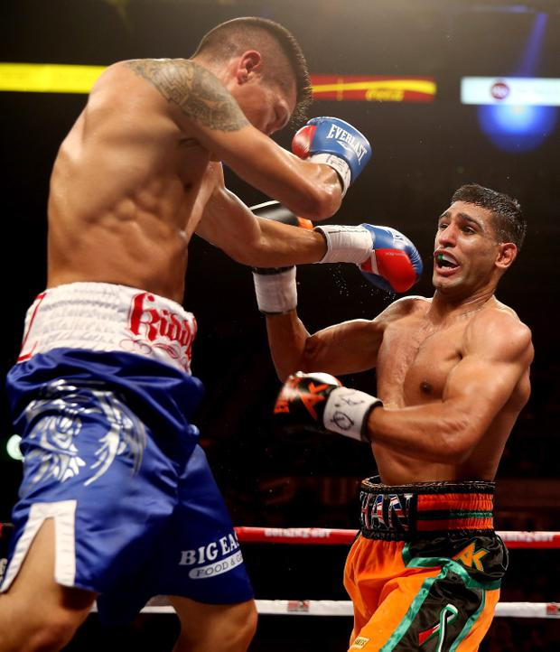 SHEFFIELD, ENGLAND - APRIL 27: Amir Khan in action against Julio Diaz at Motorpoint Arena on April 27, 2013 in Sheffield, England. (Photo by Scott Heavey/Getty Images)