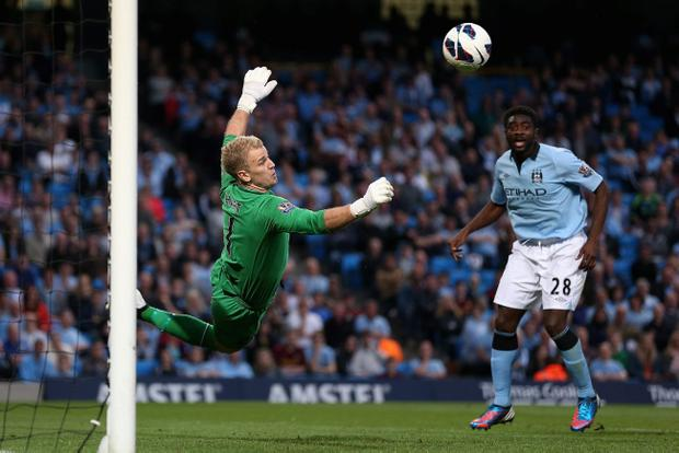 MANCHESTER, ENGLAND - MAY 07: Joe Hart of Manchester City dives to make a save during the Barclays Premier League match between Manchester City and West Bromwich Albion at the Etihad Stadium on May 07, 2013 in Manchester, England. (Photo by Clive Brunskill/Getty Images)