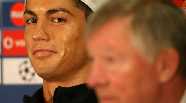 File photo dated 06/04/2009 of Manchester United's Cristiano Ronaldo with manager Sir Alex Ferguson during a press conference at Carrington Training Ground, Manchester