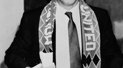 File photo dated 07/11/1986 of Manchester United's new manager Alex Ferguson at a press conference at Old Trafford, decked out in his new team's colours. PRESS ASSOCITAION Photo. Issue date: Wednesday May 8, 2013. Sir Alex Ferguson will retire at the end of this season, Manchester United have announced. See PA Story SOCCER Man Utd. Photo credit should read: PA Wire.