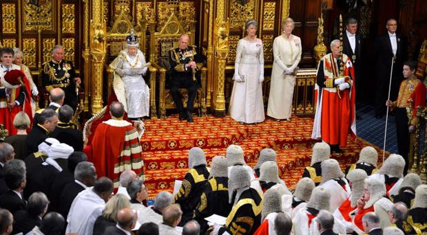 Queen Elizabeth delivers her speech at the State Opening of Parliament, in central London alongside the Duke of Edinburgh.