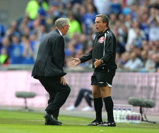 File photo dated 19/04/2009 of Manchester United manager Alex Ferguson (left) vents his frustration towards fourth official Alan Wiley (right)