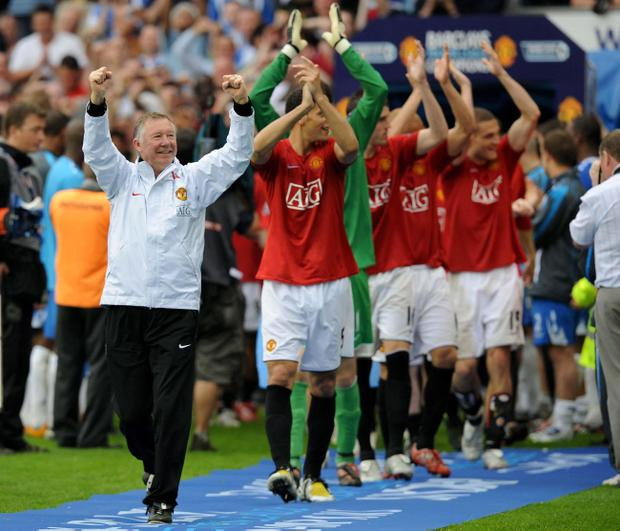 File photo dated 11/05/2008 of Manchester United players are lead out by manager Alex Ferguson to collect their trophy following the Barclays Premier League match at JJB Stadium, Wigan
