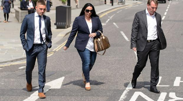 Brighton and Hove Albion footballer Anton Rodgers (left) and his father, Liverpool Manager Brendan Rodgers (right) arrive at the Old Bailey for the trial