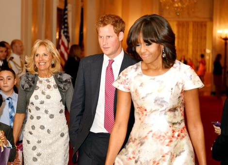 WASHINGTON, DC - MAY 09: (L-R) Dr. Jill Biden the wife of Vice President Joe Biden, HRH Prince Harry and first lady Michelle Obama prepare to attend an event to honor military families at the White House during the first day of his visit to the United States on May 9, 2013 in Washington, DC. HRH will be undertaking engagements on behalf of charities with which the Prince is closely associated on behalf also of HM Government, with a central theme of supporting injured service personnel from the UK and US forces. (Photo by John Stillwell - WPA Pool/Getty Images)
