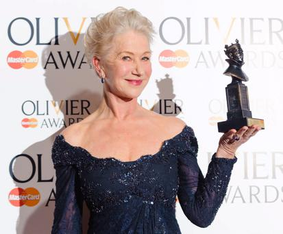 File photo dated 29/04/13 of Dame Helen Mirren with the 'Best Actress' award at the Olivier Awards 2013, the actress broke character from her regal role on Saturday evening when she yelled at a group of drummers to be quiet while still dressed in her stage costume as Queen Elizabeth II. PRESS ASSOCIATION Photo. Issue date: Monday May 6, 2013. The 67-year-old, whose performance in The Audience won her an Olivier Award last week, left London's Gielgud theatre to confront the troupe of performers. As One in the Park, who were promoting their festival for gay and transgender people due to take place in east London this month, said Dame Mirren was dressed in pearls and a tiara when she demanded the noise stop. See PA story SHOWBIZ Mirren. Photo credit should read: Dominic Lipinski/PA Wire