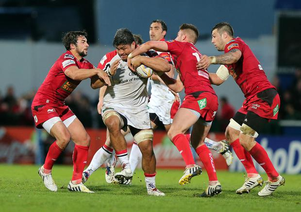 Ulster's Nick Williams tackled by Gareth Owen and Owen Williams of Llanelli Scarlets INPHO/Dan Sheridan