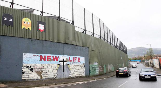 he largest peace wall in Belfast, at Cupar Way, which separates the Catholic Falls area and the Protestant Shankill area of the city