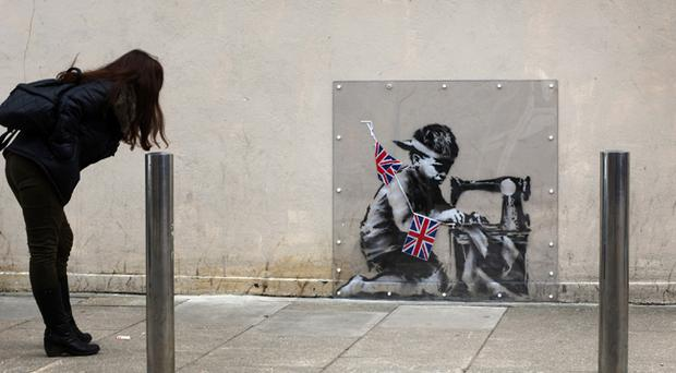 The Banksy mural appeared just before last year's Diamond Jubilee celebrations