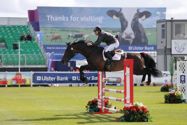Press Eye - Belfast - Northern Ireland - 15th May 2012 - First day of the 2013 Balmoral Show in partnership with Ulster Bank at the new site, Balmoral Park. Shane McFadden competes in the show jumping. Picture by Kelvin Boyes / Press Eye