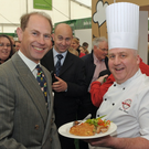 Earl of Wessex at Balmoral Show Day 1 at the new Balmoral Park site on the former Maze prison site. HRH Prince Edward is pictured with Chef Sean Owens in the foodhall. Photo by Simon Graham/Harrison Photography.
