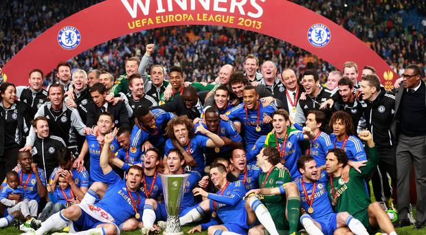 Chelsea players pose with the trophy during the UEFA Europa League Final