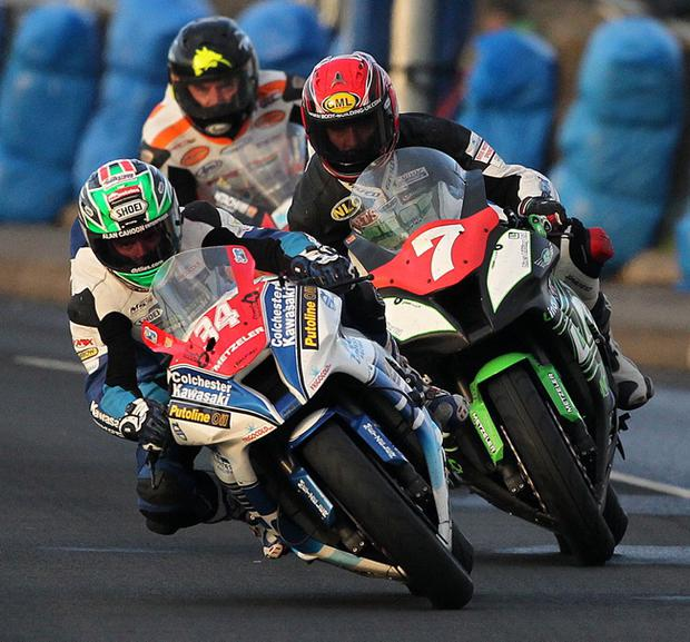 Alastair Seeley Gearlink Kawasaki (34) leads from Gary Johnston (7) and Bruce Anstey during the LIVEWIRE AV Superstock Race at Thursday night's racing at the Vauxhall International 2013 North West 200.