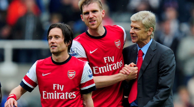 Manager Arsene Wenger of Arsenal celebrates at the final whistle with Tomas Rosicky (L) and Per Mertesacker (C) during the Barclays Premier League match between Newcastle United and Arsenal at St James' Park on May 19, 2013 in Newcastle upon Tyne, England. (Photo by Stu Forster/Getty Images)