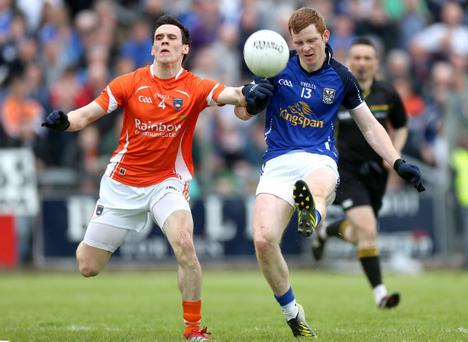 Ulster GAA Football Senior Championship Preliminary Round, Kingspan Breffini Park, Co. Cavan 19/5/2013 Cavan vs Armagh Cavan's Niall McDermott and Mark Shields of Armagh Mandatory Credit ?INPHO/Ryan Byrne