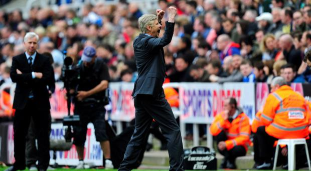 NEWCASTLE UPON TYNE, ENGLAND - MAY 19: Manager Arsene Wenger of Arsenal celebrates at the final whistle during the Barclays Premier League match between Newcastle United and Arsenal at St James' Park on May 19, 2013 in Newcastle upon Tyne, England. (Photo by Stu Forster/Getty Images)