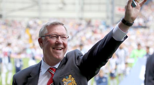 Manchester United manager Sir Alex Ferguson salutes the fans prior to kick-off during the Barclays Premier League match at the Hawthorns, West Bromwich.
