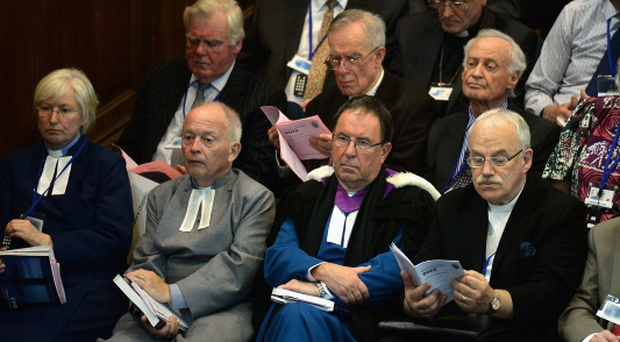 Commissioners of the Church of Scotland sit in the chamber during the debate on the issue of gay ministers on May 20,2013 in Edinburgh, Scotland. Members will be discussing whether to allow people in same sex relationships to be ordained as Ministers in the Church of Scotland. (Photo by Jeff J Mitchell/Getty Images)