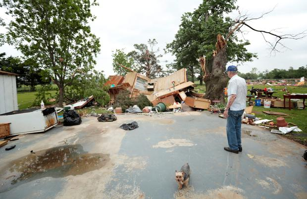 Lonnie Langston stands near his garage that was swept off the concrete pad next to his house by a tornado May 20, 2013 near Shawnee, Oklahoma