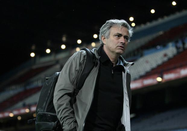 FILE - In this Saturday, April 27, 2013 file photo Real Madrid's coach Jose Mourinho from Portugal leaves the stadium following a Spanish La Liga soccer match against Atletico de Madrid at the Vicente Calderon stadium in Madrid, Spain. Real Madrid says Monday May 20, 2013, coach Jose Mourinho will leave at end of season. (AP Photo/Andres Kudacki, File)