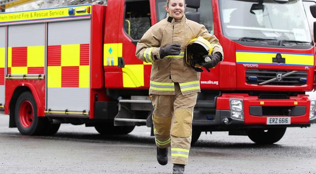 Firefighter Mary Kate who will be taking part in the Belfast Telegraph RunHer event pictured at Springfield Road Fire Station.