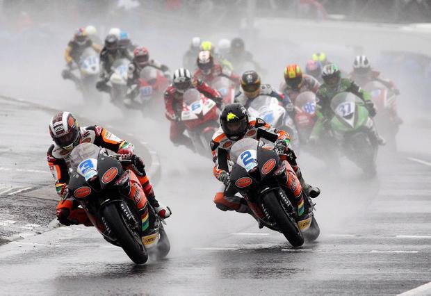 John McGuinness (3) and Bruce Anstey battle the North West downpour before racing squelched to a halt