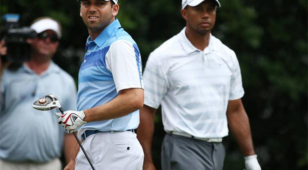 Sergio Garcia, left, and Tiger Woods