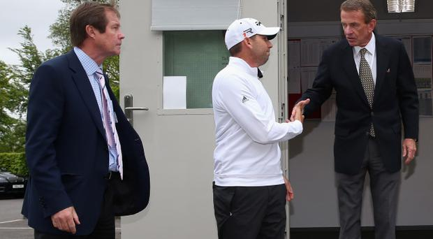 VIRGINIA WATER, ENGLAND - MAY 22: Sergio Garcia of Spain emerges from a meeting in the rules office with George O'Grady, Chief Executive of the European Tour (L) and Tim Finchem, PGA Tour Commissioner (R) during the Pro-Am round prior to the BMW PGA Championship on the West Course at Wentworth on May 22, 2013 in Virginia Water, England. (Photo by Andrew Redington/Getty Images)