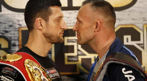 Carl Froch of Britain, left, and Mikkel Kessler of Denmark pose for media during a press conference at O2 Arena in London, Wednesday, May 22, 2013. Carl Froch fights Mikkel Kessler in a super middleweight world title unification boxing match at O2 Arena on Saturday. (AP Photo/Sang Tan)