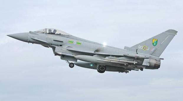 Undated handout photo issued by the Ministry of Defence of an RAF Typhoon Aircraft that has escorted a passenger plane into Stansted Airport following an incident on board