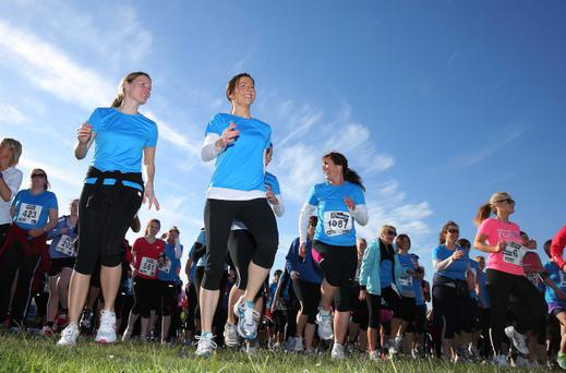 Press Eye - Belfast - Northern Ireland - Friday 24th May 2013 - BELFAST TELEGRAPH RUNHER COASTAL CHALLENGE Competitors warming up Picture by Kelvin Boyes / Press Eye