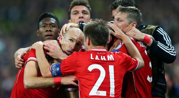 LONDON, ENGLAND - MAY 25: Arjen Robben of Bayern Muenchen (L) celebrates with team-mate Philipp Lahm after scoring a goal during the UEFA Champions League final match between Borussia Dortmund and FC Bayern Muenchen at Wembley Stadium on May 25, 2013 in London, United Kingdom. (Photo by Alex Livesey/Getty Images)