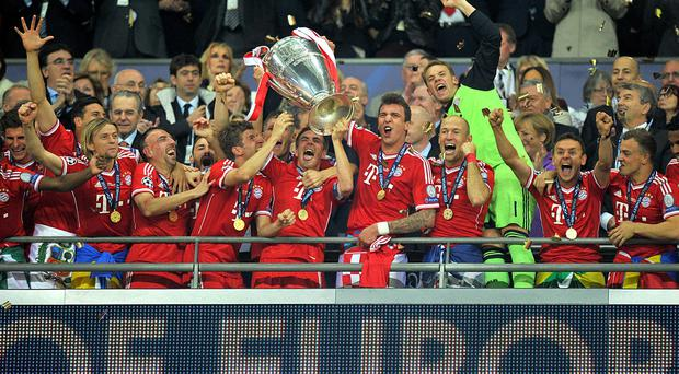Bayern Munich players celebrate as they lift the UEFA Champions League trophy during the UEFA Champions League Final at Wembley Stadium, London. PRESS ASSOCIATION Photo. Picture date: Saturday May 25, 2013.