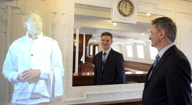 Denis Rooney, chairman of the Nomadic Charitable Trust, in the reception area with a virtual exhibit in the SS Nomadic in Belfast, which has been restored to its former glory