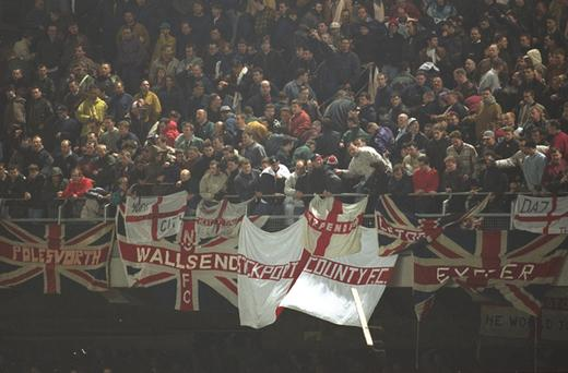 15 Feb 1995: England fans hurl debris at the fans below during an International Friendly match against the Republic of Ireland at Lansdowne Road in Dublin. The match was abandoned with the Republic leading 1-0