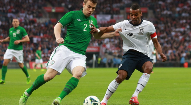 LONDON, ENGLAND - MAY 29: Ashley Cole of England battles with Seamus Coleman of the Republic of Ireland during the International Friendly match between England and the Republic of Ireland at Wembley Stadium on May 29, 2013 in London, England. (Photo by Scott Heavey/Getty Images)