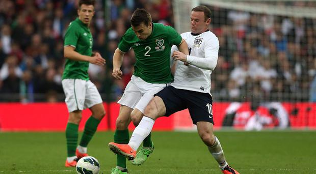 England's Wayne Rooney (right) and Republic of Ireland's Seamus Coleman battle for the ball during the International Friendly match at Wembley Stadium, London