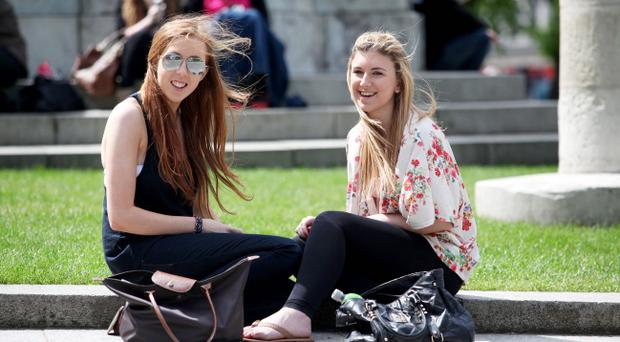 People spent their lunchtime in the grounds of the Belfast City Hall yesterday as temperatures soared. Danielle Hill and Rachel Armstrong