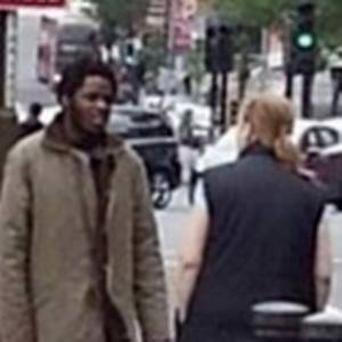 The image of mother-of-two Ingrid Loyau-Kennett, standing talking to a man with a bloodied knife in his hand