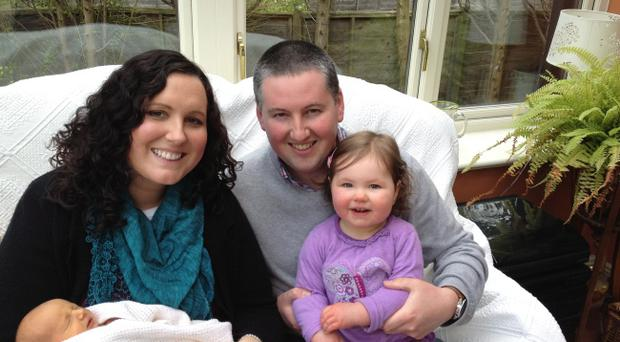 Ruth and Richard Faulkner are celebrating the birth of their son Harry. Also in the picture is their daughter Hannah