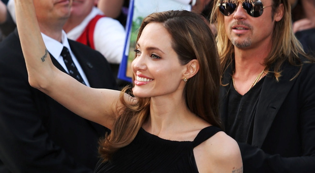 LONDON, ENGLAND - JUNE 02: Angelina Jolie & Brad Pitt attends the World Premiere of 'World War Z' at The Empire Cinema on June 2, 2013 in London, England. (Photo by Tim P. Whitby/Getty Images)